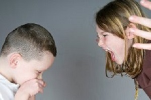 Older girl yelling at younger boy
